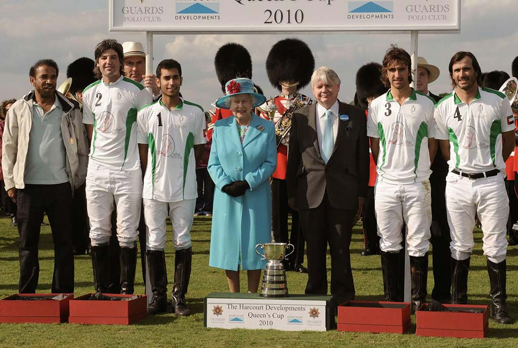 Ali Albwardy with the Queen of England
